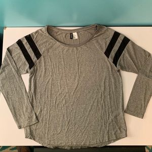 Cute gray top with black mesh stripes at shoulder